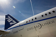 Aircraft's title on side of the Boeing-manufactured 787 Dreamliner (N787BX) at the Farnborough Airshow. On its first flight outside of the US during its testing programme, the newest airliner in the Boeing aviation family, has arrived at the air show for a few days of exhibitions to the aerospace-buying community and the trade press. Later the public will have the chance to see this jet up close too. The Boeing 787 Dreamliner is a long range, mid-sized, wide-body, twin-engine  jet airliner developed by Boeing Commercial Airplanes. It seats 210 to 330 passengers, depending on variant. Boeing states that it is the company's most fuel-efficient airliner and the world's first major airliner to use composite materials for most of its construction
