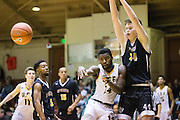 San Francisco Dons guard Charles Minlend (14) passes to a teammate against the San Francisco Dons host the San Francisco State University Gators at Kezar Pavilion in San Francisco, Calif., on December 6, 2016. (Stan Olszewski/Special to S.F. Examiner)