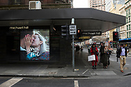 Pedestrians walk past a Michael Hill jewelry store at the corner of Little Collins and Elizabeth Streets in the Central Business District of Melbourne, Australia.