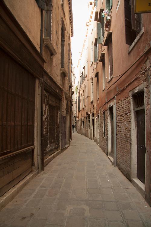 Narrow old Venice street with pedestrian