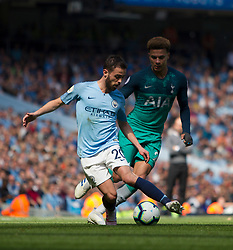Bernardo Silva of Manchester City (L) and Dele Alli of Tottenham Hotspur in action - Mandatory by-line: Jack Phillips/JMP - 20/04/2019 - FOOTBALL - Etihad Stadium - Manchester, England - Manchester City v Tottenham Hotspur - English Premier League