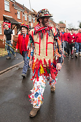 """© Licensed to London News Pictures. 06/01/2016. Haxey UK. Picture shows Dale Smith """"the fool"""" leading the crowd at The Haxey Hood that takes place today, The historic event dating back to the 14th century sees teams representing four pubs in Haxey & Westwoodside compete for a leather cylinder known as the hood. After a pub crawl around the participating pubs, the game begins with a famous speech from the ceremonial fool. The game is won when the scrum reaches one of the pubs and the hood is touched by the landlord or landlady. Photo credit: Andrew McCaren/LNP"""