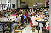 Large group of people mainly women playing bingo, Tarxien, Malta