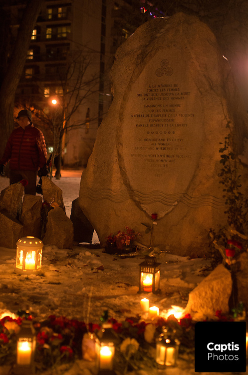 The Women's Monument during a candle light vigil for the victims of the Ecole Polytechnique shooting in Montreal. December 6, 2014