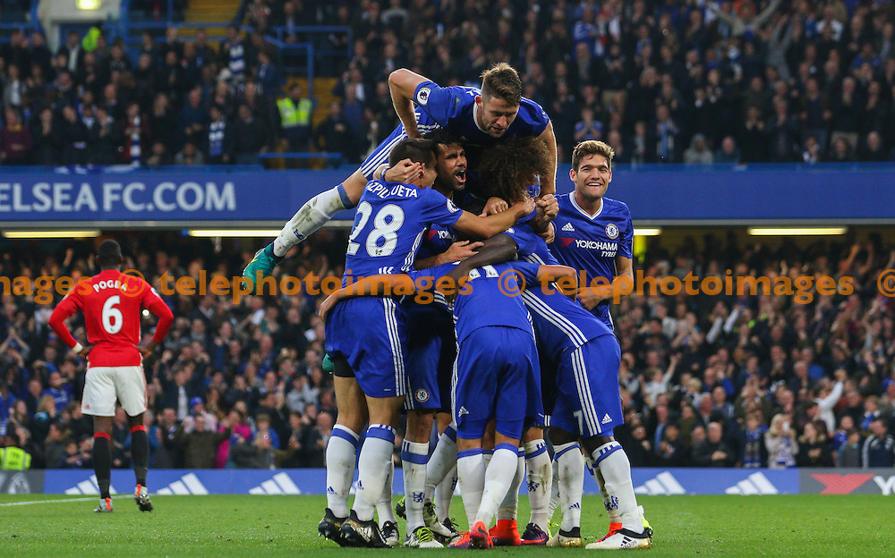 Ngolo Kante of Chelsea celebrates scoring during the Premier League match between Chelsea and Manchester United at Stamford Bridge in London. October 23, 2016.<br /> Arron Gent / Telephoto Images<br /> +44 7967 642437