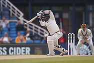 Off drive from Yorkshire All-rounder Adil Rashid  during the Specsavers County Champ Div 1 match between Yorkshire County Cricket Club and Surrey County Cricket Club at Headingley Stadium, Headingley, United Kingdom on 10 May 2016. Photo by Simon Davies.