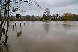 A riverside pub's jetty lies submerged under the swiftly flowing waters of the River Thames at Aston near Henley, as heavy rains in the catchment area and saturated ground cause the river to rise to within inches of bursting its banks. April 02 2018.