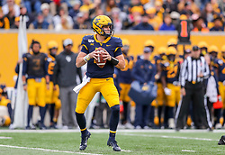 Nov 23, 2019; Morgantown, WV, USA; West Virginia Mountaineers quarterback Jarret Doege (2) drops back to pass during the first quarter against the Oklahoma State Cowboys at Mountaineer Field at Milan Puskar Stadium. Mandatory Credit: Ben Queen-USA TODAY Sports
