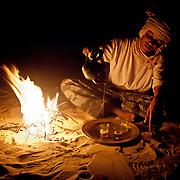 Tuareg tea ceremony in campsite  near Timbuktu, Mali .