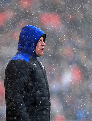 Everton manager Sam Allardyce in the snow during the Premier League match at the bet365 Stadium, Stoke.
