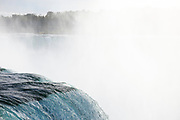 SHOT 10/21/17 3:04:35 PM - A heavy mist forms off of the Horseshoe Falls, also known as Canadian Falls, which is the largest of the three waterfalls which collectively form Niagara Falls on the Niagara River along the Canada-US Border. Approximately 90% of the Niagara River, after diversions for hydropower generation, flows over Horseshoe Falls. The remaining 10% flows over American Falls and Bridal Veil Falls. It is located between Terrapin Point on Goat Island in the US state of New York, and Table Rock in the Canadian province of Ontario. (Photo by Marc Piscotty / © 2017)