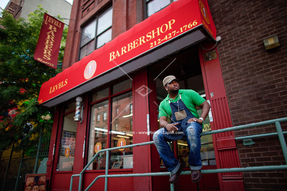 Stylist Rico London has become well known at Levels Unisex, a barber shop in East Harlem. He's particularly known for his the sculptured designs.  ..Photo by Robert Caplin