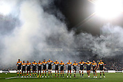 Chiefs players lineup to pay tribute to Sir Fred Allen before the game. Super Rugby rugby union match, Chiefs v Hurricanes at Waikato Stadium, Hamilton, New Zealand. Saturday 28th April 2012. Photo: Anthony Au-Yeung / photosport.co.nz