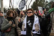 """Rally members, remembering the death of editor-in-chief of the bilingual Turkish-Armenian newspaper Agos, Hrant Dink, wore scarves and held placards stating """"We are all Hrant, We are all Armenian""""."""