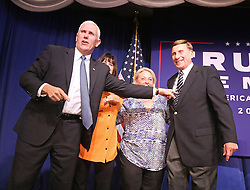 Republican vice presidential candidate Mike Pence, with his wife Karen, U.S. Rep. John Mica (far right) and Mica's wife Patricia (second from right), responds to cheering supporters as he takes the stage at a rally on Monday, Oct. 31, 2016 in Maitland, FL, USA. Photo by Joe Burbank/Orlando Sentinel/TNS/ABACAPRESS.COM