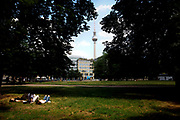 Berlin's TV-tower is seen as people enjoy a warm day on the lawn in the Mittte district in Berlin, Germany, July 10, 2021.