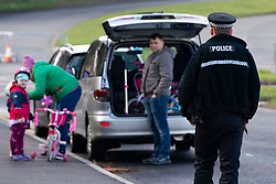 Edinburgh, Scotland, UK. 31 March, 2020. Police patrol public parks and walking areas to enforce the coronavirus lockdown regulations about being outdoor. Police patrol Marine Drive and talk to family arriving for a walk.  Iain Masterton/Alamy Live News