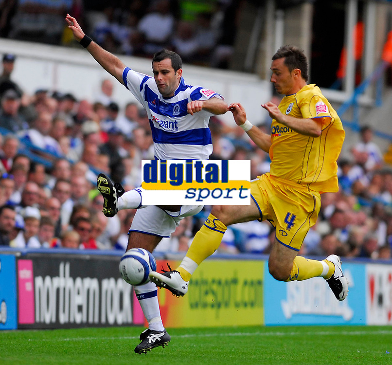 Photo: Leigh Quinnell.<br /> Queens Park Rangers v Southampton. Coca Cola Championship. 01/09/2007. QPRs Chris Barker battles in the air with Southamptons Marek Saganowski.