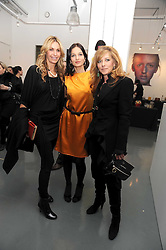 Left to right, MELISSA ODABASH, YASMIN MILLS and KELLY HOPPEN at a party to celebrate the launch of the Bobbi Brown Makeup Manual held at the Getty Images Gallery, 46 Eastcastle Street, London W1 on 29th January 2009.