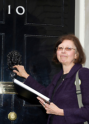 ©under licence to London News Pictures. 18/05/11. London, UK  . Campaigners from Lewisham, Camden & Swindon assembled to protest against the cuts at Department of Culture, Media and Sport, and then delivered a petition to 10 Downing Street. Picture shows Patricia Richardson from Lewisham about to hand in the petition to No 10. Please see special instructions for usage rates. Photo credit should read TONY NANDI/LNP