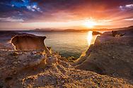 Rocky sea shore of Milos island at sunrise