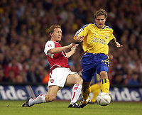 Photo: Richard Lane<br /> The FA Cup Final 2003<br /> Arsenal v Southampton. Millenium Stadium Cardiff. 17/05/2003<br /> Ray Parlour tackles Anders Svensson