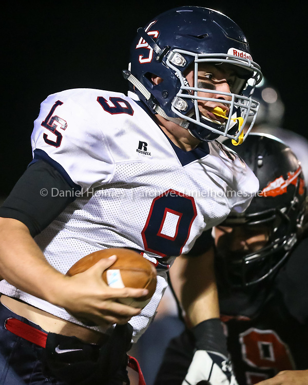 (9/25/15, WAYLAND, MA) Lincoln-Sudbury's Dan Ryan runs to avoid the sack during the football game against Wayland at Wayland High School on Friday. Daily News and Wicked Local Photo/Dan Holmes
