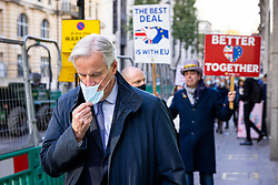 © Licensed to London News Pictures. 13/11/2020. London, UK. European Union Chief Negotiator MICHEL BARNIER  removes his face mask after leaving The Westminster Conference Centre where ongoing Brexit negotiations are taking place. Photo credit: Rob Pinney/LNP