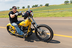 Gary Maurer of Kustoms Inc in Grand Ledge, MI rides back to Sturgis after the annual Michael Lichter - Sugar Bear Ride hosted by Jay Allen with the Easyriders Saloon during the Sturgis Black Hills Motorcycle Rally. SD, USA. Sunday, August 3, 2014. Photography ©2014 Michael Lichter.