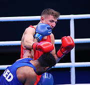 Marcel Rumpler of Austria (red) and Delano James of The Netherlands (bue) competing in the Men's Welterweight preliminaries during The Road to Tokyo European Olympic Boxing Qualification, Sunday, March 15, 2020, in London, United Kingdom. (Mitchell Gunn-ESPA-Images/Image of Sport)
