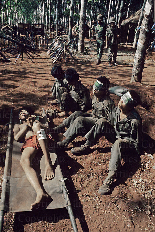 Captured North Vietcong soldiers seen under guard of the South Vietnamese army in April 1975. Photograph by terry Fincher
