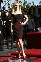12/1/2010 Reese Witherspoon poses by her Walk of Fame star