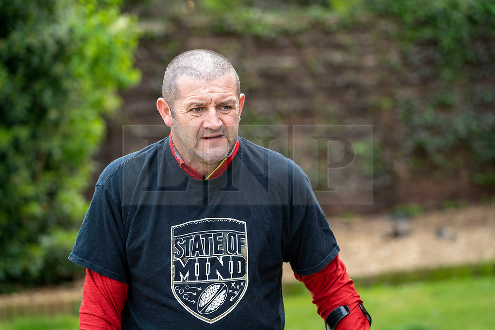 © Licensed to London News Pictures. 26/04/20. Wakefield, UK. <br />A 46 year old quadriplegic from Wakefield has been inspired by Captain Tom Moore  to walk 26 laps of his home to raise money for charity. Ex-rugby player Jimmy Gittens was left paralysed after breaking his neck in 2002. He started his challenge on crutches at 8am on Saturday and completed just before lunchtime on Sunday. <br />Jimmy was supported by his wife Lucy, a frontline NHS paramedic, and children Annie and Jed. He said ' I have spent a lot of time with the NHS due to my injuries and thought what I can do to help.' The longest time I have managed to walk  since my accident is about 15 minutes so this was a bit of a challenge!'  <br />Jimmy is raising funds for two sports health charities , State of Mind and the Steve Prescott Foundation, as part of the 2.6 Challenge.  Photo credit: Scott Merrylees/LNP