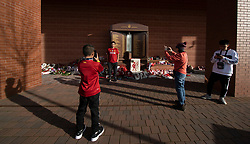 LIVERPOOL, ENGLAND - Tuesday, March 17, 2020: Supporters take selfies near the Hillsborough Memorial at a near deserted Anfield, home of Champions-elect Liverpool Football Club, after the suspension of all football due to the Coronavirus (COVID-19) and Liverpool's decision to close it's Boot Room cafe and official stores. (Pic by David Rawcliffe/Propaganda)
