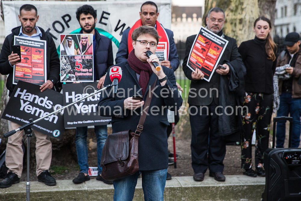 London, UK. 26th March, 2019. Andrew Smith of Campaign Against the Arms Trade addresses human rights campaigners from several different groups including Stop The War Coalition and Campaign Against the Arms Trade protesting opposite Downing Street against British arms sales to Saudi Arabia used to wage a 4-year war in Yemen. According to charity Save The Children, an estimated 85,000 children under the age of five may have died from acute malnutrition since the war began in 2015 and 14 million Yemenis are believed to face the risk of famine; according to the United Nations, millions of citizens have been displaced, over 56,000 Yemenis have been killed and the country is facing the 'world's worst humanitarian crisis'.