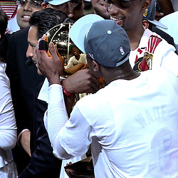 Jun 21, 2012; Miami, FL, USA; Miami Heat power forward Chris Bosh (1)and shooting guard Dwyane Wade (3) celebrates with the Larry O'Brien Trophy after winning the NBA championship in game five of the 2012 NBA Finals against the Oklahoma City Thunder at the American Airlines Arena. Miami won 121-106. Mandatory Credit: Derick E. Hingle-US PRESSWIRE