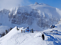 Skiers and snowboarders stop for a rest at the top of the Headwall before descending the mountain recently at Jackson Hole Mountain Resort. An incoming winter storm is forecast to bring more snow to the Tetons this week.