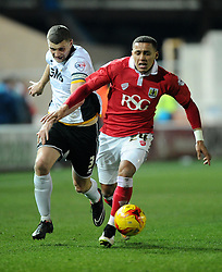 Bristol City's James Tavernier battles for the ball with Port Vale's Carl Dickinson  - Photo mandatory by-line: Joe Meredith/JMP - Mobile: 07966 386802 - 10/02/2015 - SPORT - Football - Bristol - Ashton Gate - Bristol City v Port Vale - Sky Bet League One