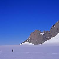 Expedition skiers pass Rakekniven spire in Filchner Mountains.