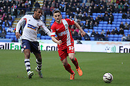 Bolton's Neil Danns and Blackburn's Craig Conway compete for the ball. Skybet championship match, Bolton Wanderers v Blackburn Rovers at the Reebok Stadium in Bolton, England on Saturday 1st March 2014.<br /> pic by David Richards, Andrew Orchard sports photography.