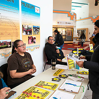 """Targol Mesbah (right), picks up a festival program and speaks with Teracita Keyanna (left) at the International Uranium Film Festival at the Navajo Nation Museum in Window Rock, Thursday, Nov. 29. Mesbah travelled to the festival from California where she does research on contamination from uranium mining and depleted uranium weapons. Keyanna is from the Red Water Pond Road  community near Church Rock and several of her family members are featured in the film """"Tale of a Toxic Nation"""" which screened Thursday at the festival."""