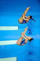 London, England, 12-02-25. Zi HE and Minxia WU (CHN) competing in the women's 3m spring board at the 18th FINA Visa World Cup Diving, Olympic Aquatics Centre. Part of the London Prepares Olympic preparations.