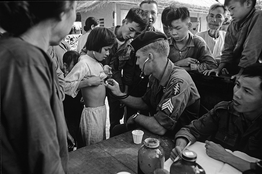 US medic of the 101st Airborne Division (green berets) seen helping villagers from the Montagnards tribe in the central Highlands of Vietnam in 1969. Photographed by Terry Fincher