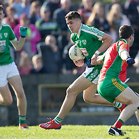 Kilrush Shamrock's Gearoid O'Brien is tackled by O'Curry's-Naomh Eoin's Cathal Downes