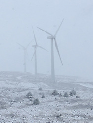 © Licensed to London News Pictures. 12/01/2017. Mid Wales, UK. Snow covers the hills and obscures the Cefn Croes Windfarm, Eisteddfa Gurig, inland from Aberystwyth, Ceredigion Wales UK  . Photo credit: Keith Morris/LNP