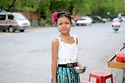 Portrait of a young girl working at a street food stall  on 24th May 2016 in Mandalay, Myanmar