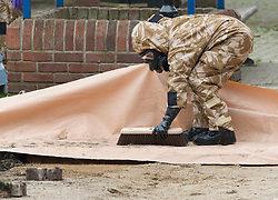 © Licensed to London News Pictures. 24/04/2018. Salisbury, UK. Members of the armed forces clean up after removing contaminated soil in the area at the Maltings where a bench was earlier removed as the cleanup operation begins in Salisbury. Former Russian Spy Sergei Skripal and his daughter Yulia were poisoned using a nerve agent in the city last month. Experts have warned that 'Toxic levels' of the nerve agent novichok could still be present at hot spots around the city. Photo credit: Peter Macdiarmid/LNP