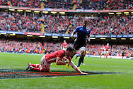 Alex Cuthbert of Wales © dives in to score the opening try. RBS Six nations champs 2012, Wales v France at the Millennium Stadium in Cardiff, South Wales on Saturday 17th March 2012.  pic by Andrew Orchard, Andrew Orchard sports photography,