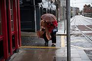 Women walk down Parkgate Street on December 2, 2011 in Dublin, Ireland.