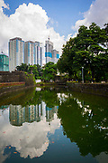 A view of the Manila skyline behind the Pasig River in Intramuros, Manila, Metro Manila, Philippines.